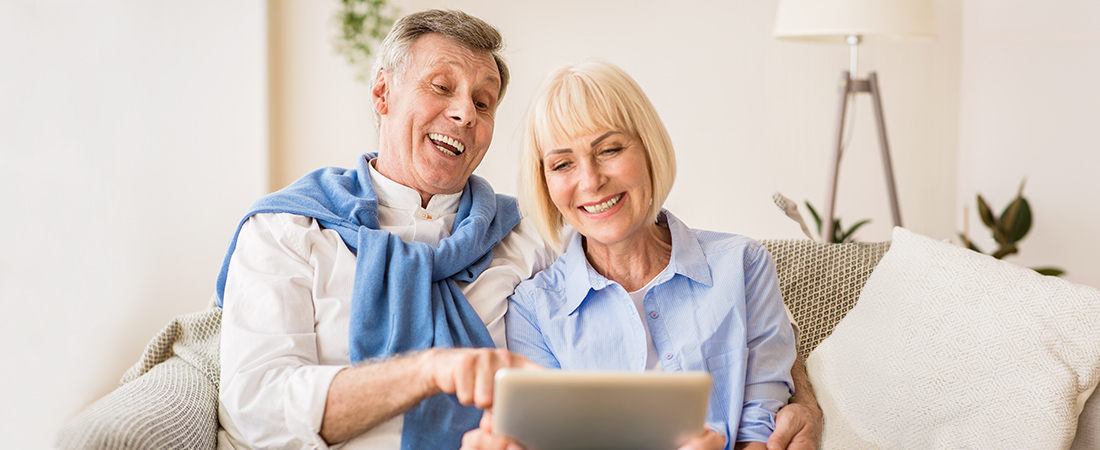 Older Couple looking at a virtual tour